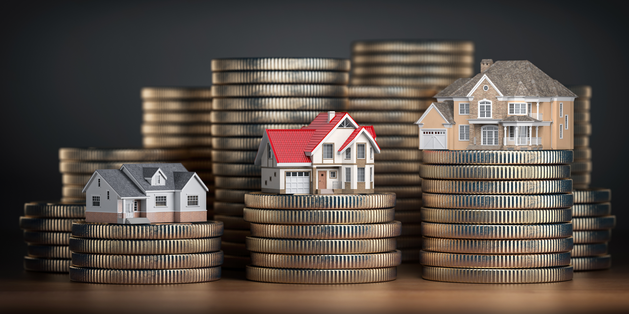 Houses of different size with different value on stacks of coins. Concept of property, mortgage and real estate investment
