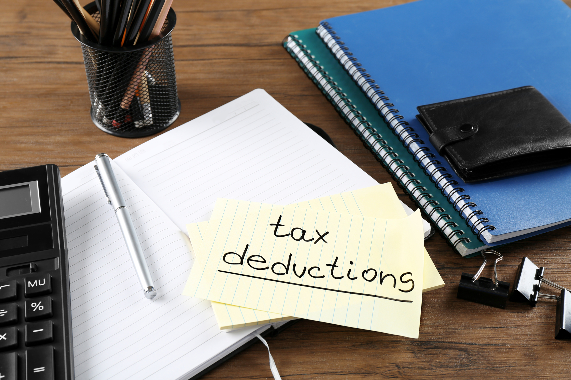 Paper sheet with text TAX DEDUCTIONS